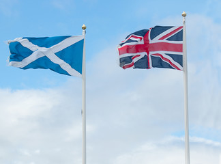 scotland and british flags in wind