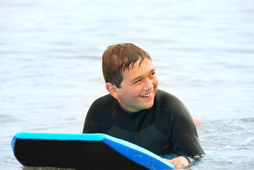 Smiling Teen Surfer