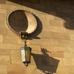 Lantern shadow on the wall.