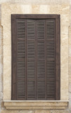 Window with brown shutters.