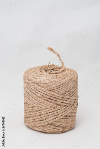 a roll of hemp rope isolated on white background.