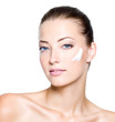 woman with moisturizer cream on face