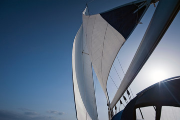 wind in yacht sails with beautiful cloudless sky