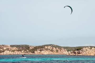 Kiteboarder enjoy surfing near Sardinia coast
