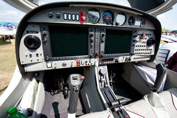 controls and equipment in cockpit of small sport airplane