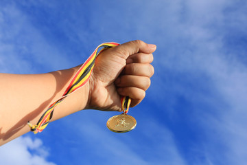 medal and hand