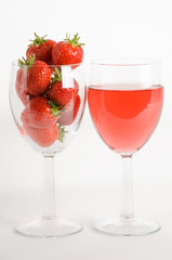 strawberries and wine in glasses