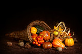 Fototapety Cornucopia with pumpkins on brown background