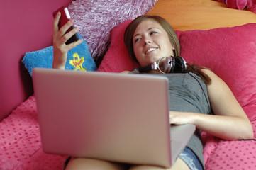 Teenager using mobile phone