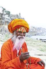 Portrait of a old Sadhu at the ghats in Varanasi, India.
