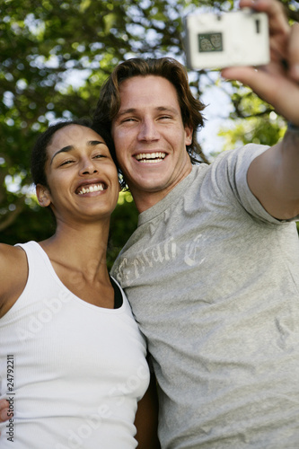 Couple taking self portrait with digital camera