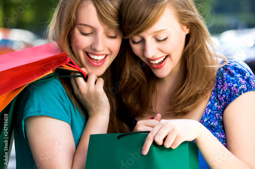 Women looking in shopping bags