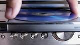insert cd disc in music center poster