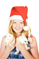 girl in santa hat with  rabbits