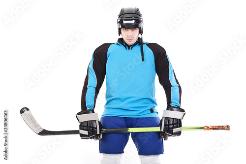 Portrait of ice-hockey player with hockey stick