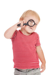 little child with magnifier on her eye