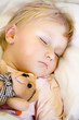 sleeping child with teddy bear