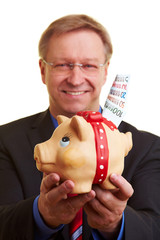Manager mit Sparschwein und Geld