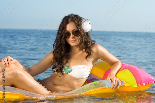 Woman relaxing on an air mattress