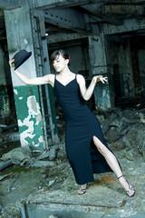 caucasian elegant dancer performing in demolished construction