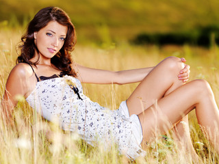 Beautiful  sexy caucasian woman on  meadow