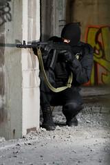 Terrorist in uniform with AK-47 rifle