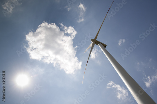 windpower with sun and blue sky