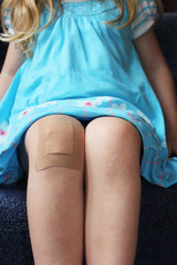 girl with plaster on her knee