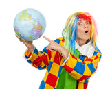 Funny clown point to the globe ball