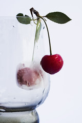 Wineglass with cherry.
