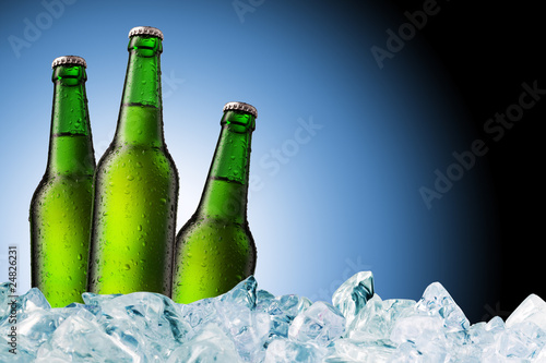 Beer Bottle with water drops on the white