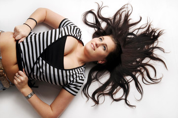 Atractive brunette in striped black and white T-shirt