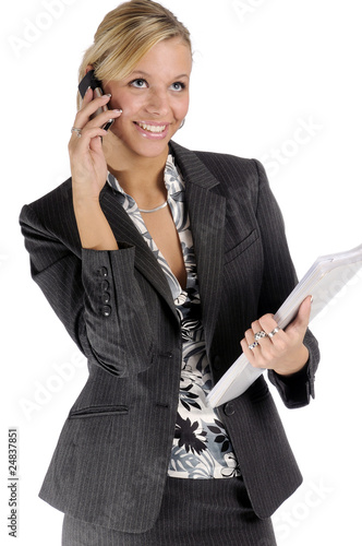 Businesswoman in black two-piece suit with mobile phone