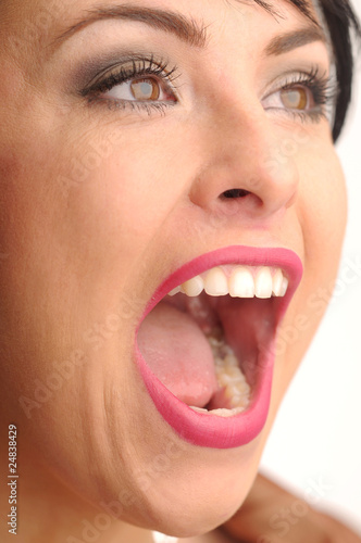 Crying atractive woman with pink lips and white tooth