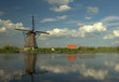 Kinderdijk :reflected windmill with clouds