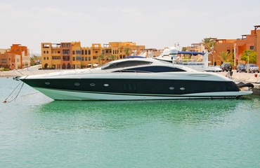Large private motor yacht in a marina