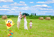 Happy family with pregnant wife fly a kite together in summer
