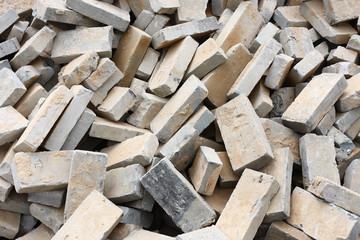 Pile of gray bricks at site of street repair