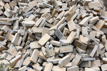 Pile of gray bricks at site of street repair