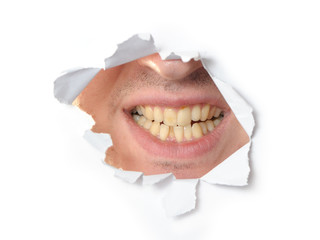 Jaws in a hole of paper