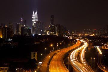 Kuala Lumpur cityscape, with Petronas towers illuminated.