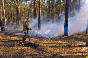Fireman in forest fire in Russia