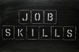 JOB SKILLS in stencil letters on a blackboard poster