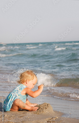 cute girl playing on beach