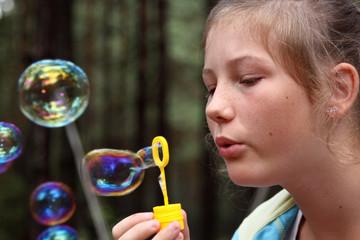 blowing soap bubbles