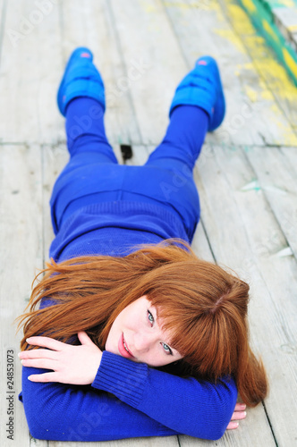 laying redheaded girl
