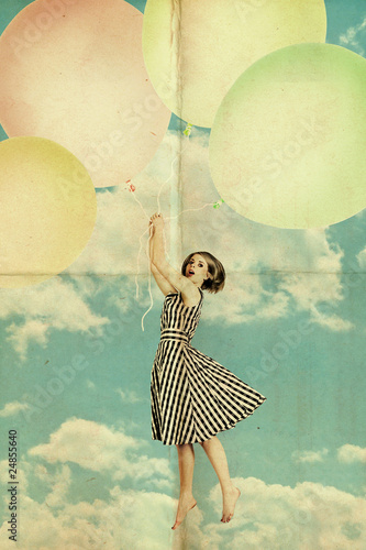 Fototapeta woman on air balls in blue sky with clouds