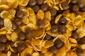 Cornflakes and cocoa balls background.