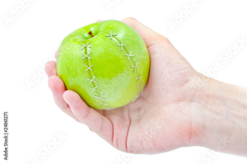 poster of green apple in a masculine hand
