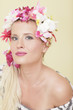 Attractive woman with flowers wrapped around her head
